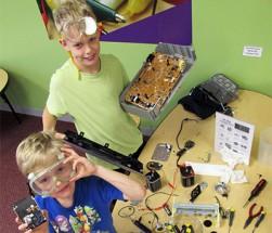 boys taking apart machines